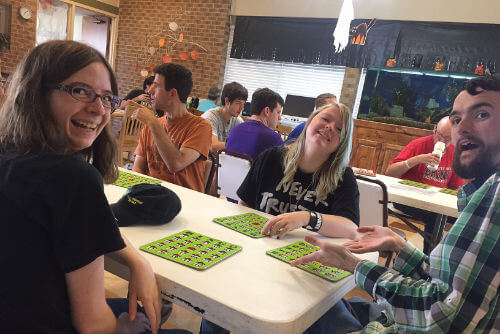 Conor, Abi and Kat enjoying a game of bingo - CLE Austin